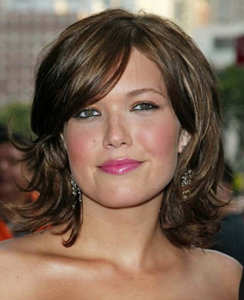 Mandy Moore with a lovely layered bob cut with full bangs.