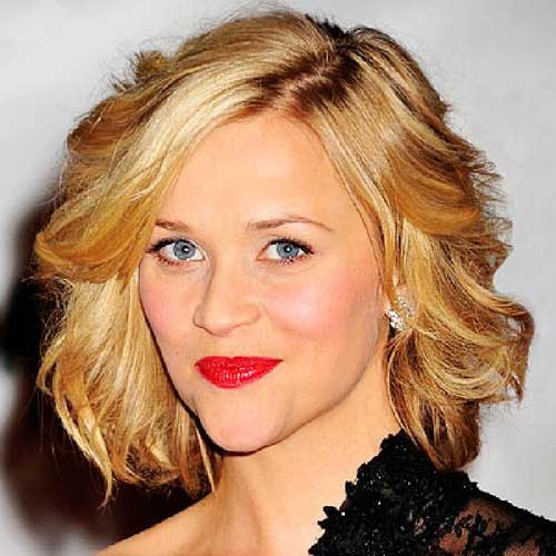 Wavy haircut provides a soft romantic look.
