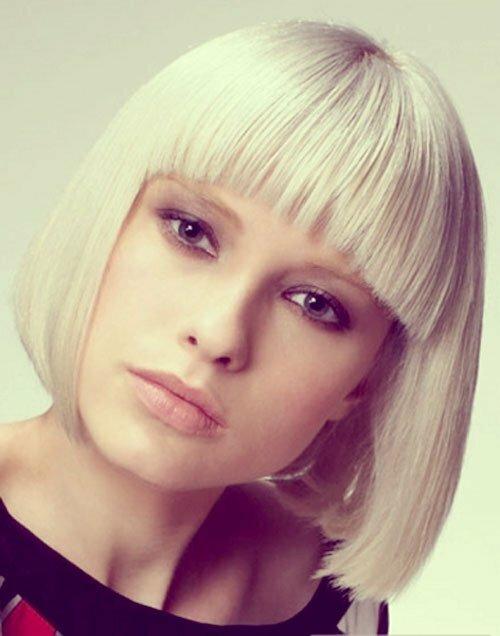Platinum blonde bob with bangs