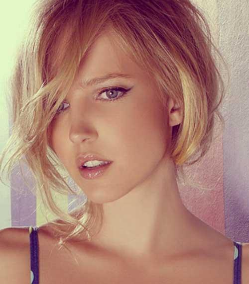 Short blonde hair with long bangs
