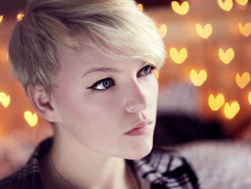 Short blonde haircut with bangs