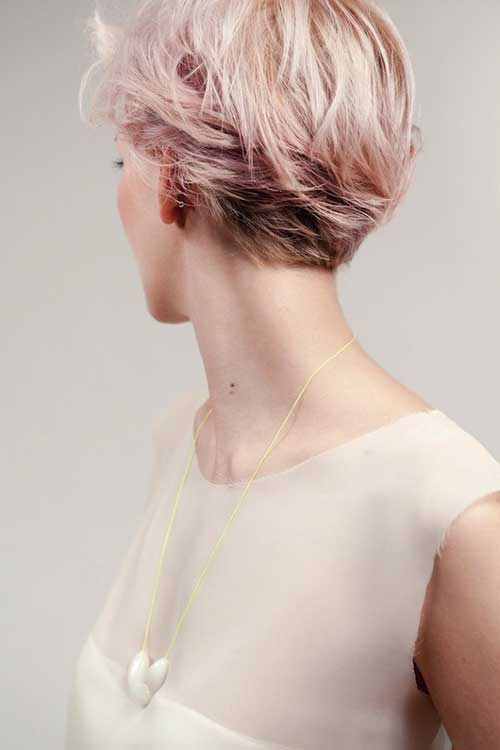 Short blonde hair with pink highlights