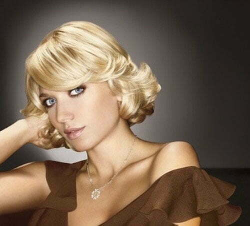 Blonde short wavy hair with side bangs