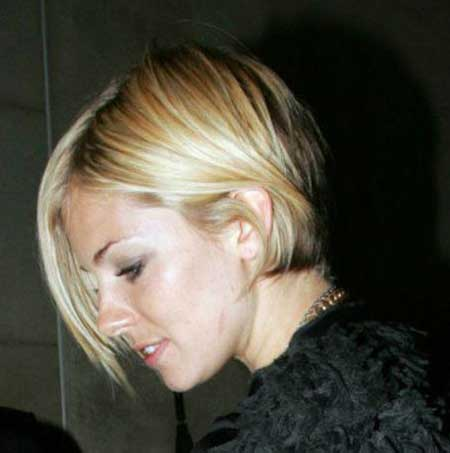 Short Bob with Long Bangs Blond Style