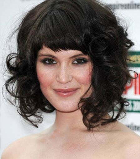 Short Bangs Dark Curly Hairstyle