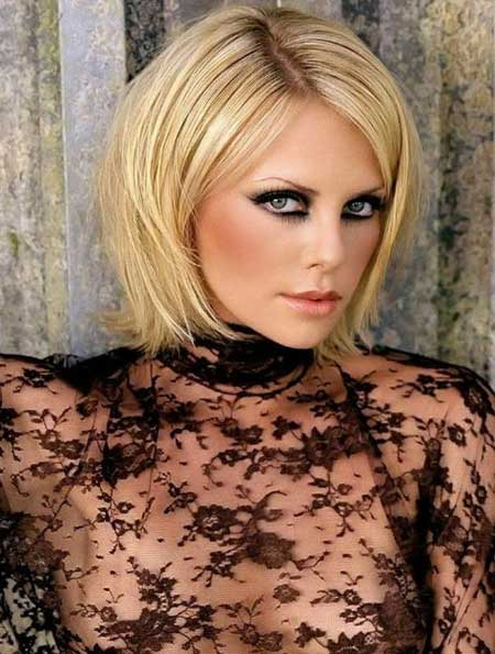 Charlize Theron Pixie Cut with Side-swept Bangs