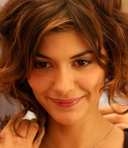Short Bouncy Wavy Hairstyle with Short Bangs