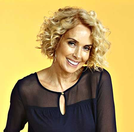 Short Side Swept Blonde Colored Curly Hairdo