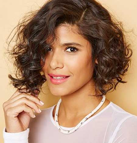 Curly Asymmetrical Hairstyle for Girls