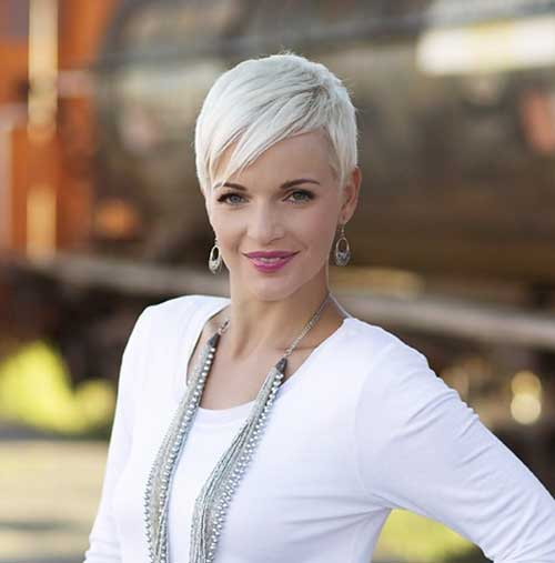 Side Swept White Colored Pixie Haircut with Long Bangs