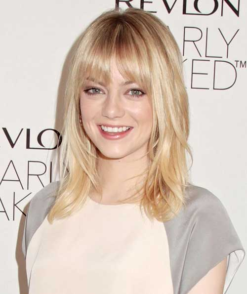 Short Blonde Medium Length Haircut With Bangs